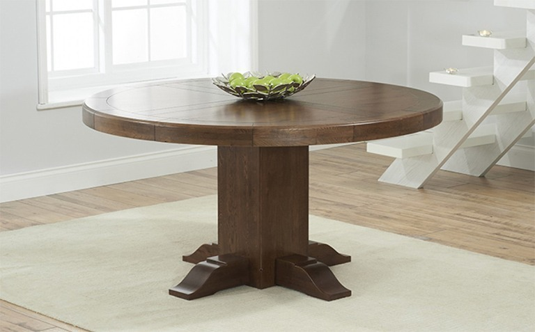 Oval and Round Dark Wood Tables