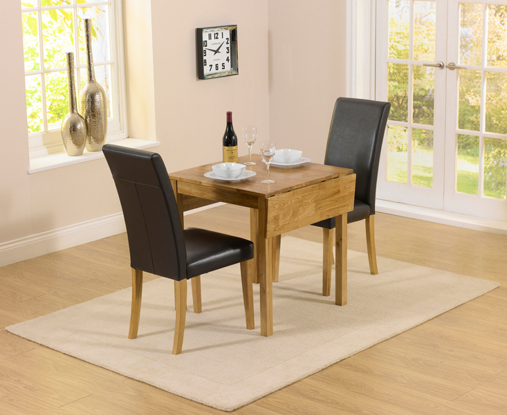Product photograph showing Oxford 70cm Solid Oak Extending Dining Table With Albany Black Chairs