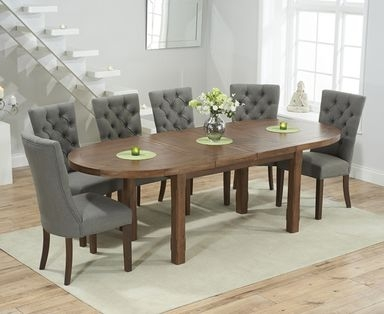 Product photograph showing Chelsea Dark Oak Extending Dining Table With 8 Anais Fabric Dark Oak Leg Chairs