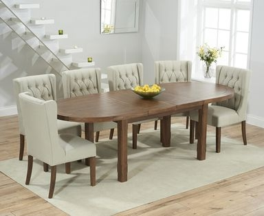 Product photograph showing Chelsea Dark Oak Extending Dining Table With Safia Fabric Dark Oak Leg Chairs