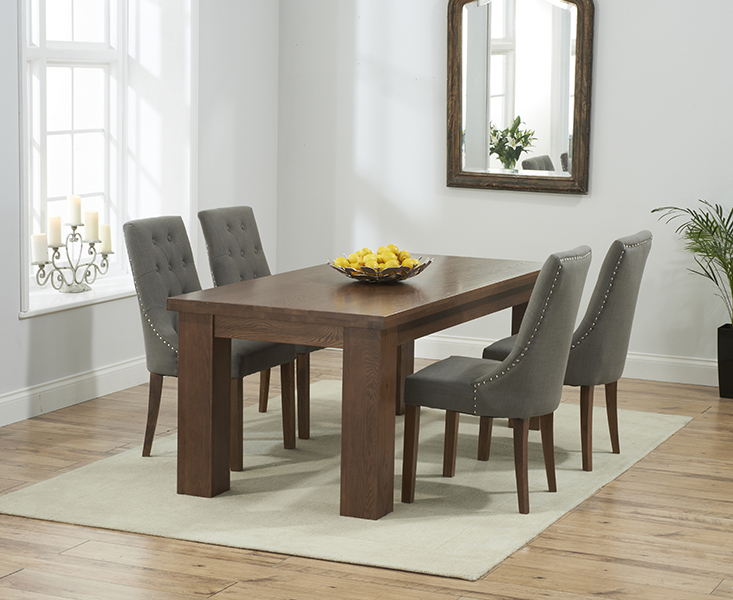 Photo of Kentucky 150cm dark oak dining table with charcoal grey pacific fabric dark oak leg chairs
