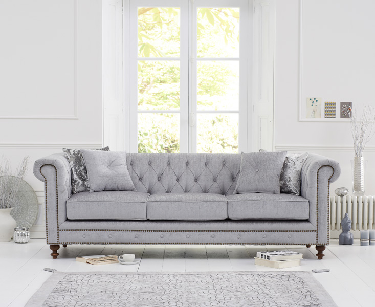 Product photograph showing Milano Chesterfield Grey Fabric 3 Seater Sofa