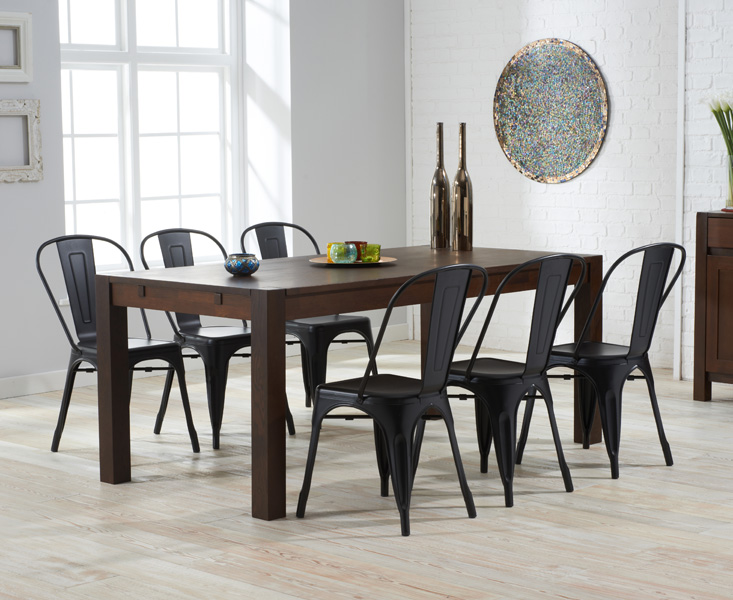 Photo of Verona 180cm dark solid oak extending dining table with tolix industrial style dining chairs