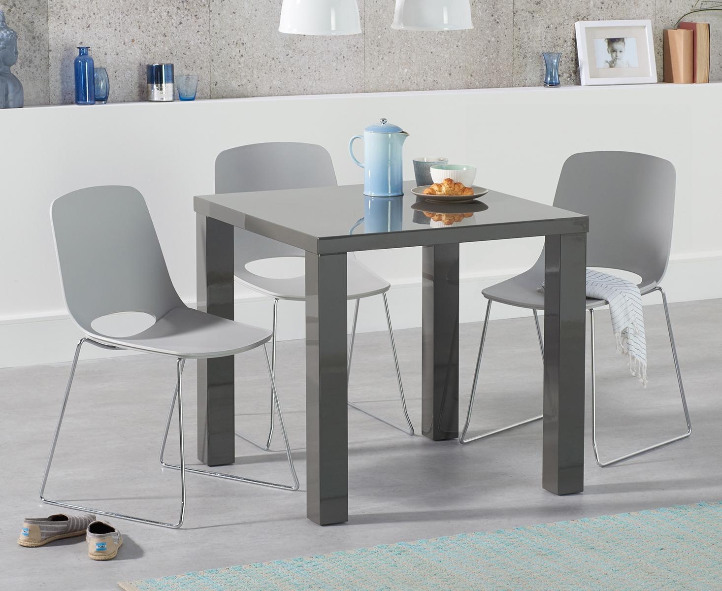 An image of Atlanta 80cm Dark Grey High Gloss Dining Table with Nordic Sled Chrome Leg Chair...