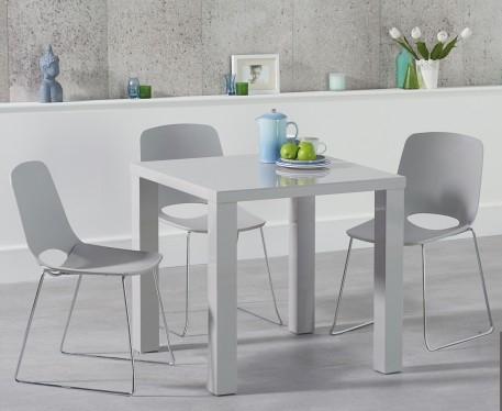 An image of Atlanta 80cm Light Grey High Gloss Dining Table with Nordic Sled Chrome Leg Chai...