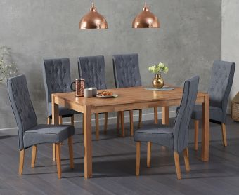 The Oxford 150cm Oak Dining Table features a clear lacquer finish, practical straight legs and a discreet finger-jointed design, with Jasper Fabric Chairs in grey, cream, brown or black.