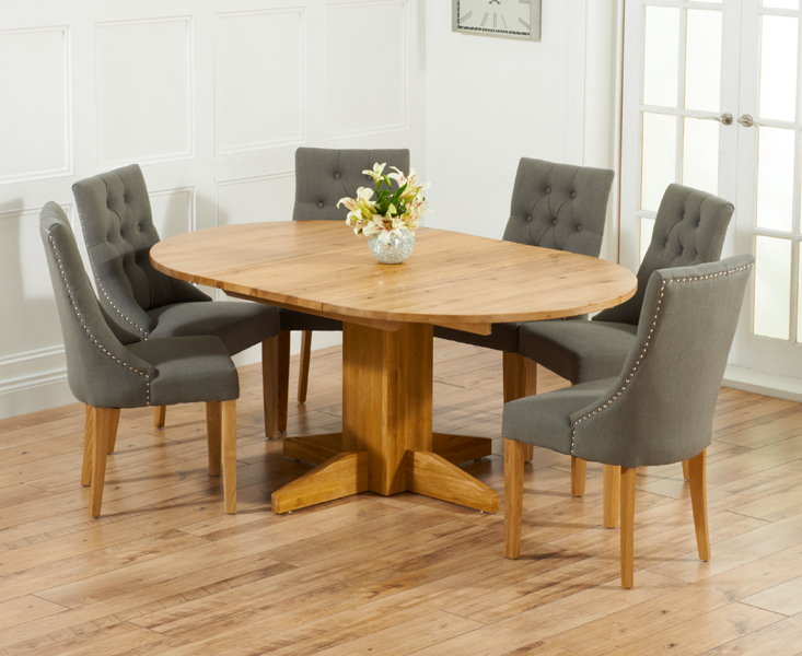 Product photograph showing Dorchester 120cm Solid Oak Round Extending Dining Table With Charcoal Grey Pacific Fabric Chairs