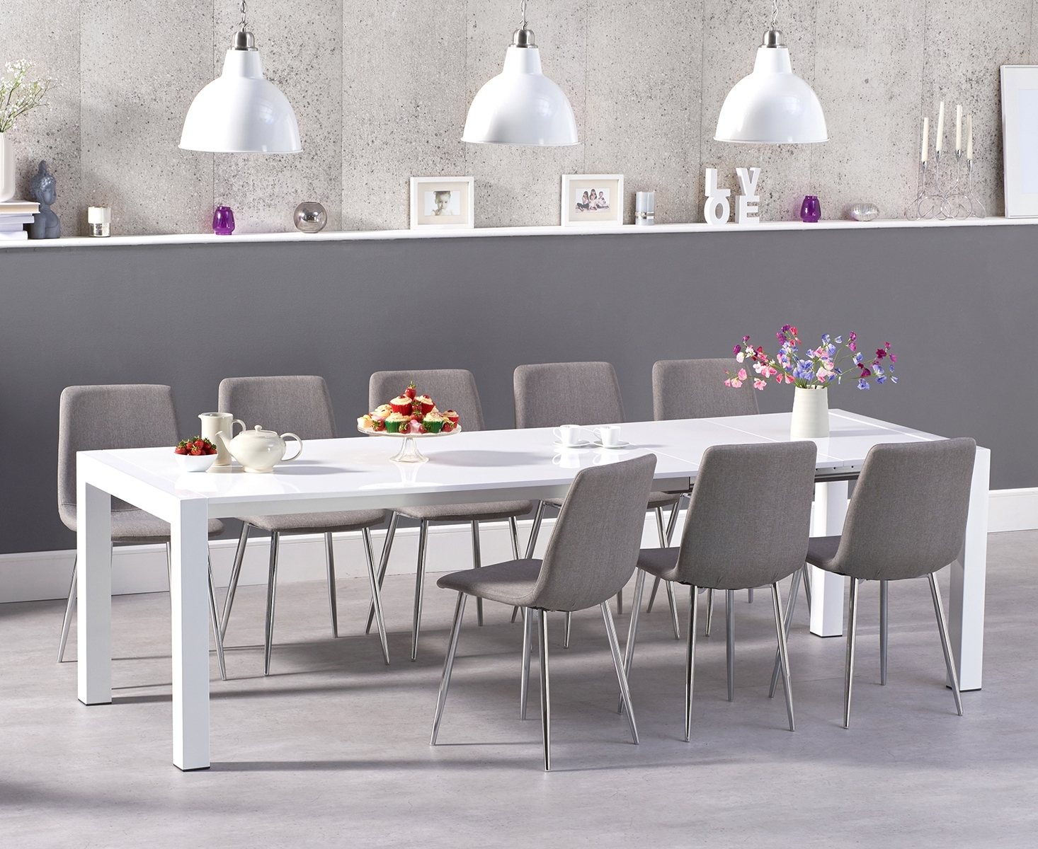 An image of Jacobi Extending White High Gloss Table with Hamburg Fabric Chrome Leg Chairs