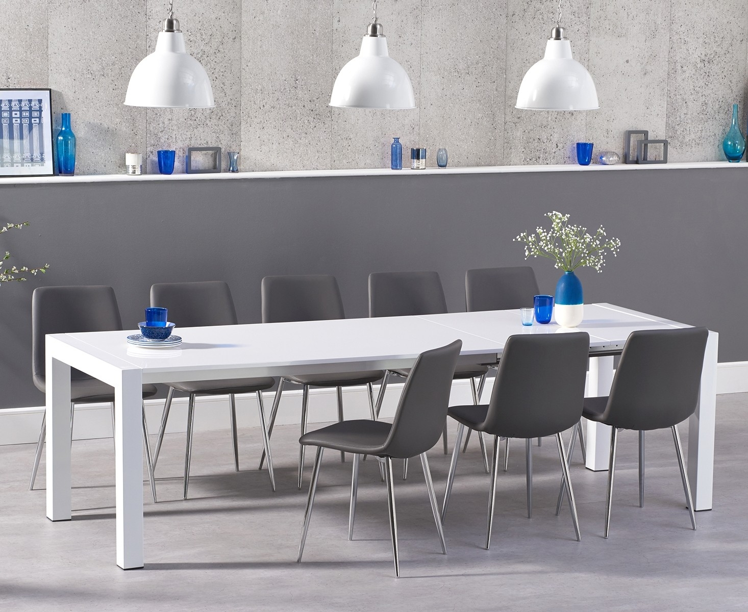 An image of Jacobi Extending White High Gloss Table with Hamburg Faux Leather Chrome Leg Cha...