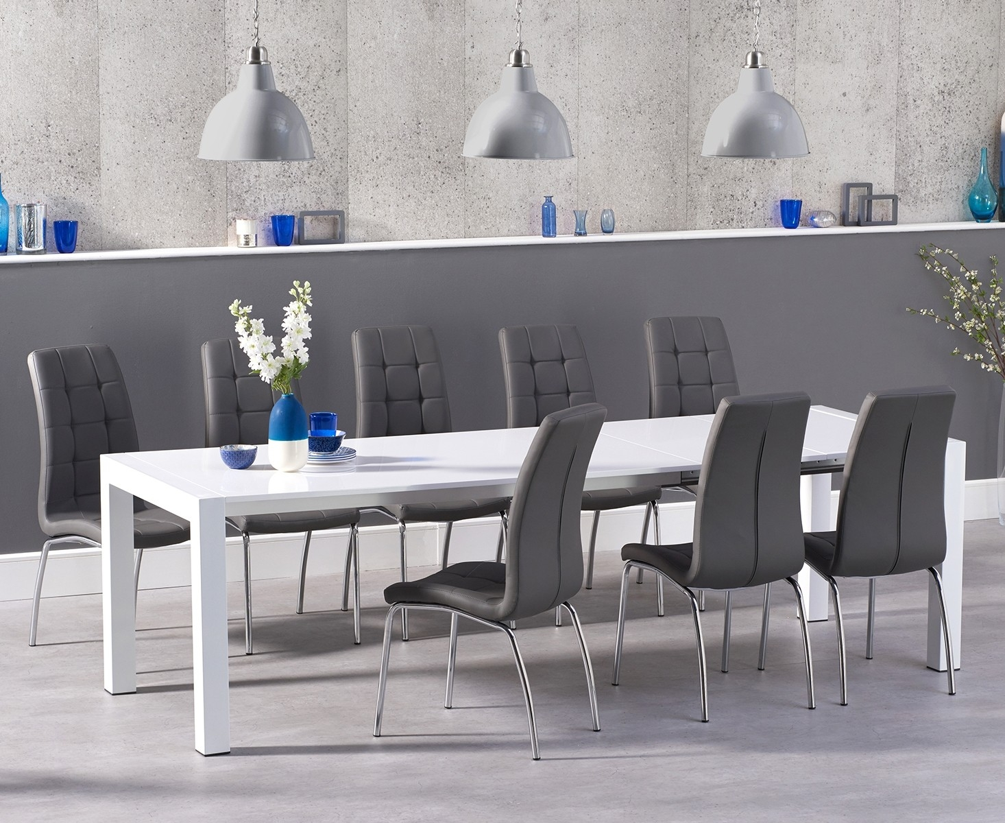 An image of Jacobi Extending White High Gloss Table with Calgary Chairs