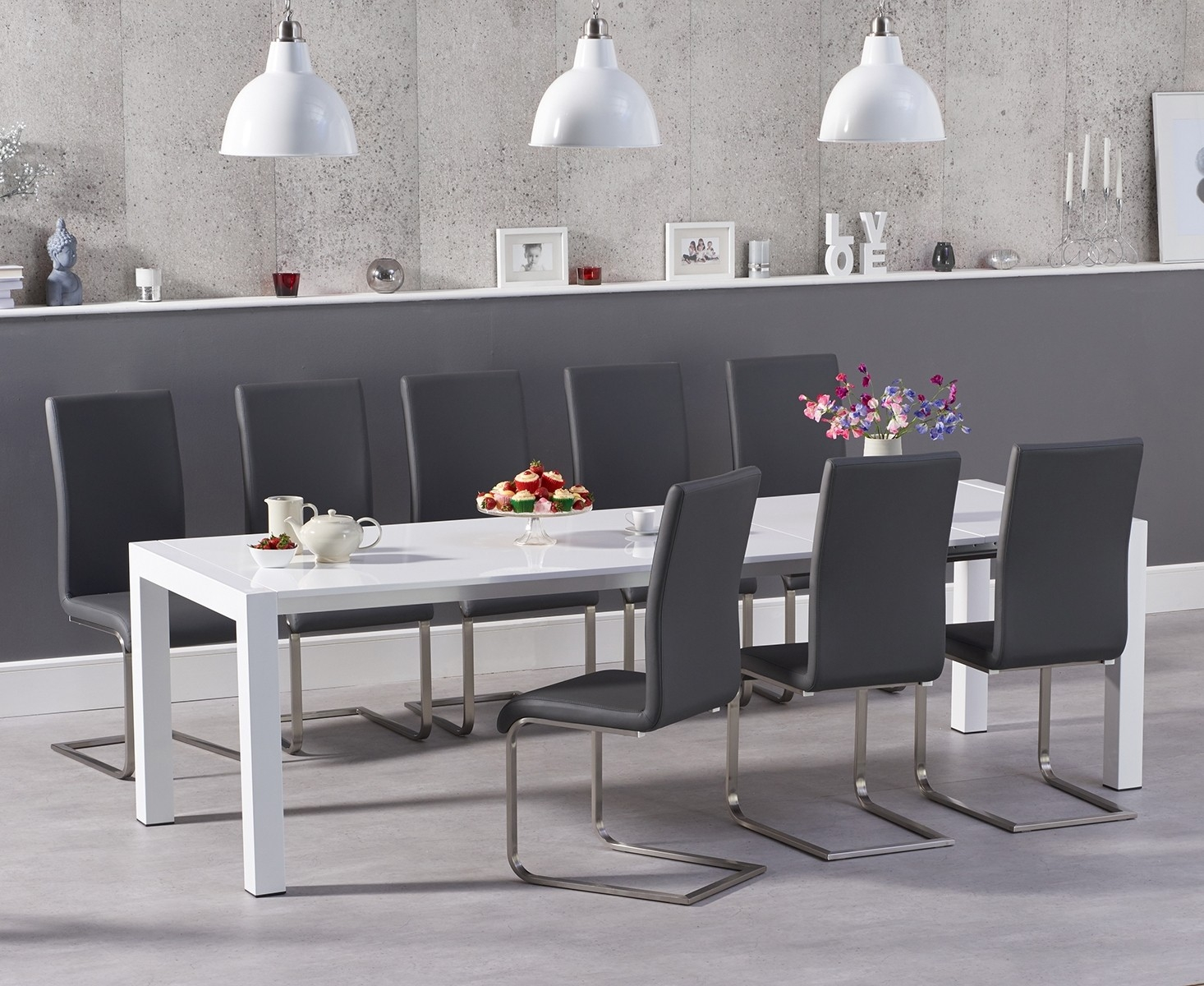 An image of Jacobi Extending White High Gloss Table with Malaga Chairs