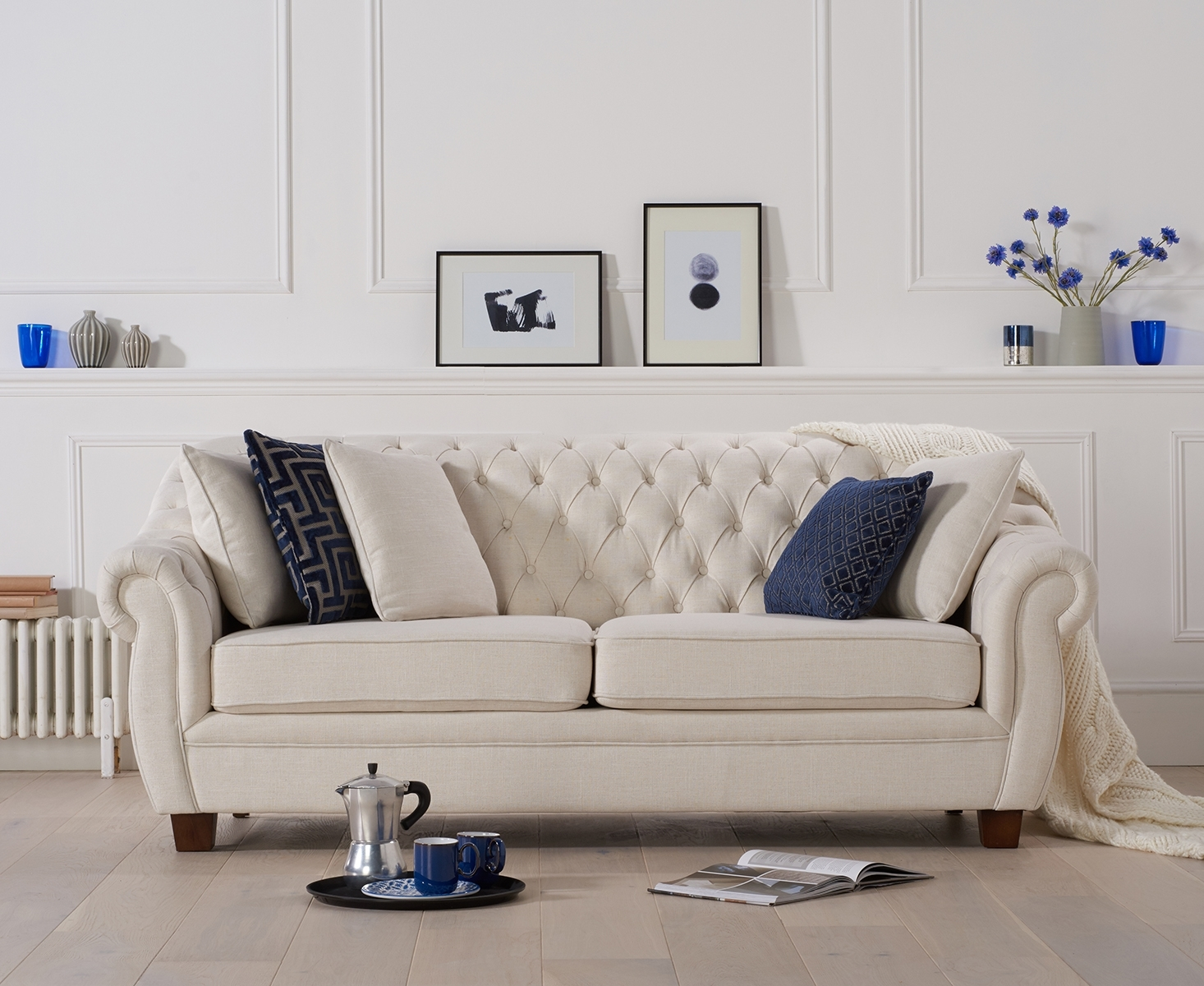 Lacey Chesterfield Ivory Fabric Three-Seater Sofa