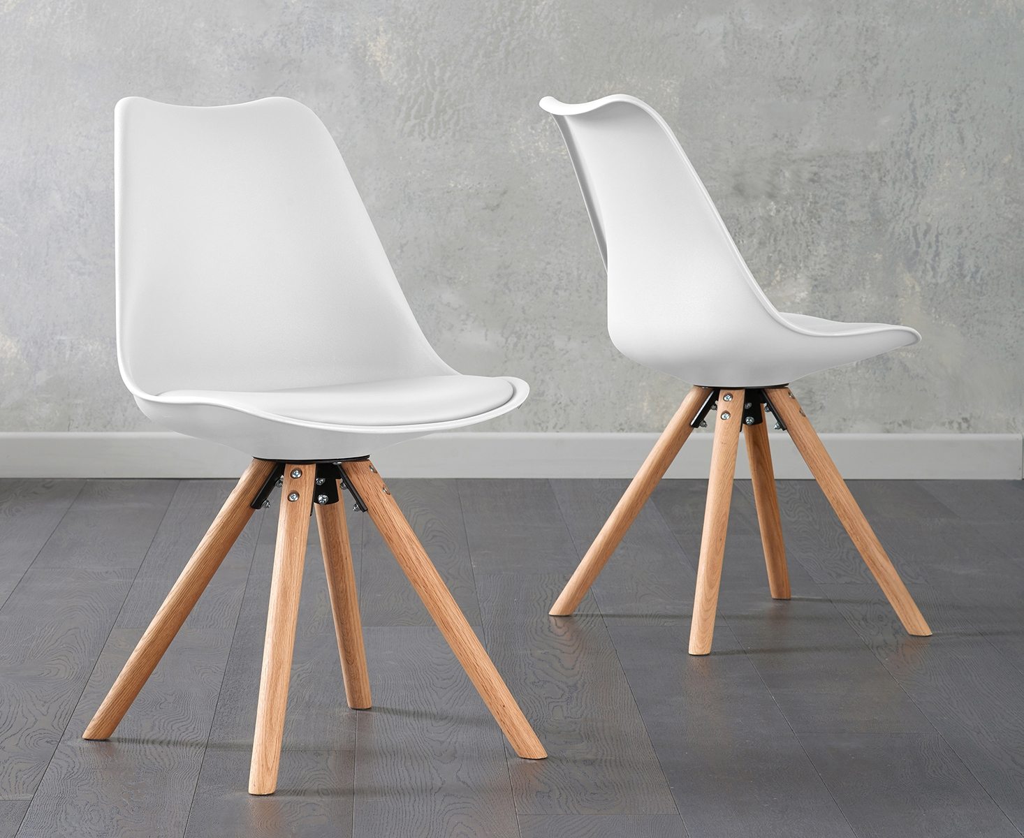 An image of Ophelia White Faux Leather Round Leg Chairs (Pairs)