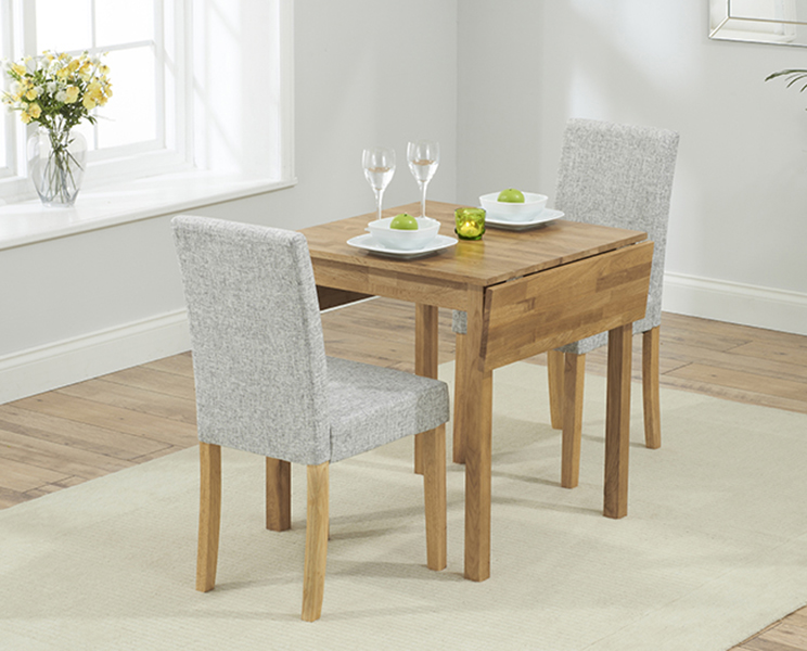 Product photograph showing Oxford 70cm Solid Oak Extending Dining Table With Grey Mia Fabric Chairs