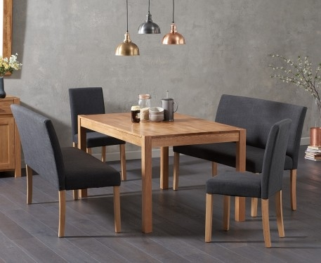 An image of Oxford 150cm Solid Oak Dining Table with Mia Black Benches with Backs and Mia Ch...