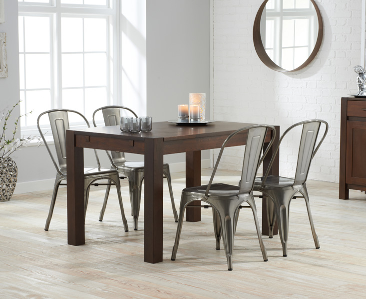 Photo of Verona 120cm dark solid oak dining table with tolix industrial style dining chairs